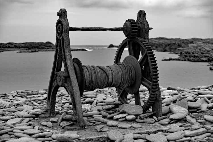 An old rusting winch which was used to pull boats in and out of the water at Scotchport, Co Mayo. Photo: Anthony Hickey