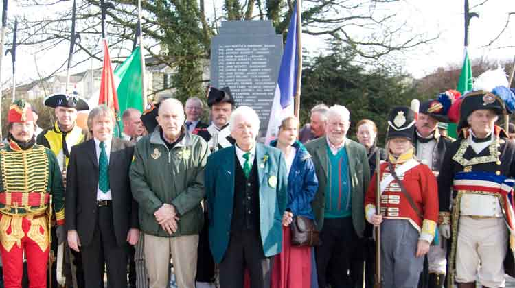 The French Re-Enactors and North Mayo Pikemen at the the Great War Monument in Ballina on St. Patrick's Day. Also included are PJ Clarke, Chairman of Ballina Comrades of the Great War and John Brown, Ballina Brass Band.