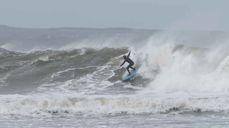 A surfer moving through the waves at Enniscrone. Photo: Anthony Hickey