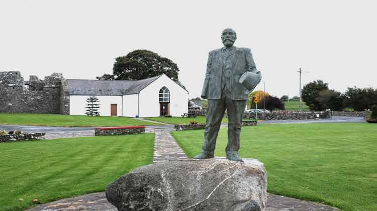 The statue of Michael Davitt (25 March 1846 – 30 May 1906) in front of the restored 17th century Straide Church which houses the museum in his honour in Straide, Co Mayo. Photo: Anthony Hickey