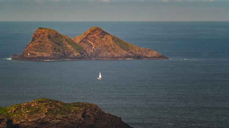 A yacht sailing by the Stags of Broadhaven. Co Mayo. Photo: Anthony Hickey