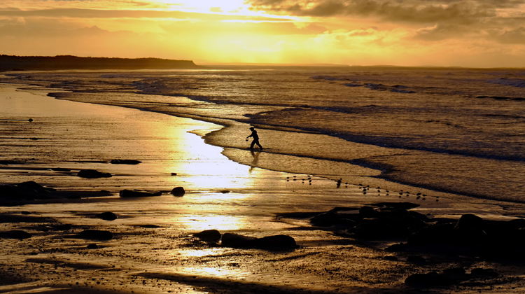 A child plays on Cross beach in Erris, Co Mayo, at sunset, Tuesday January 5, 2016. Photo: Anthony Hickey