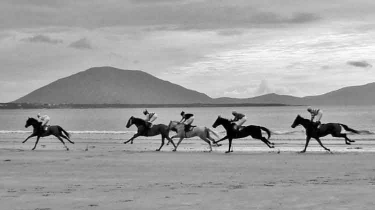 Horse racing on Doolough beach near Geesala in Co Mayo on August 16th 2015 against the majestic backdrop of Slievemore, Achill. Photo: Anthony Hickey