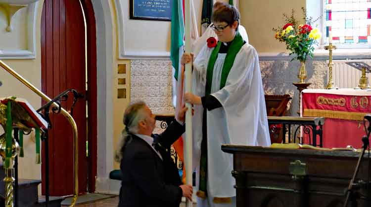 Flag bearer, Noel Gillard, hands over the national flag to Rev. Jen McWhirter at the Remembrance Service in St. Michael's Church, Ballina, Co Mayo. Photo: Anthony Hickey