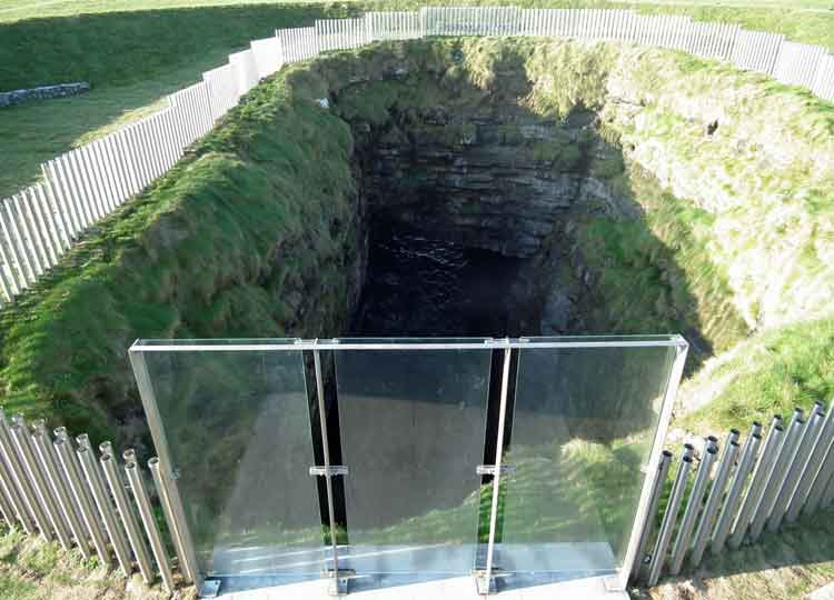 The view from the platform, overlooking the blowhole at Downpatrick Head, surrounded by a protective steel rod, flute fence. Photo: Anthony Hickey