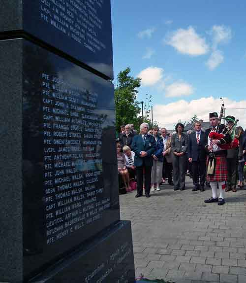 PJ Clarke, Chairman of the Ballina Comrades of the Great War Committee, Cecile Dejardain, Athis Mons, An Taoiseach Enda Kenny TD, stand in silence as the piper, Sean Lavin, played 'A Lament for the Dead', at the Great War Remembrance Monument in the Green Park, Ballina, on Saturday June 20th 2015. Photo: Anthony Hickey