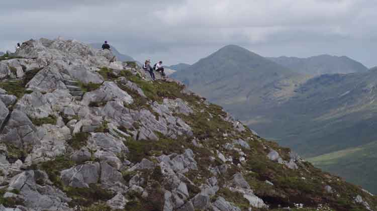 Top of the world: At the summit of Diamond Hill, Connemara National Park, enjoying the views of the Twelve Bens. Photo Anthony Hickey