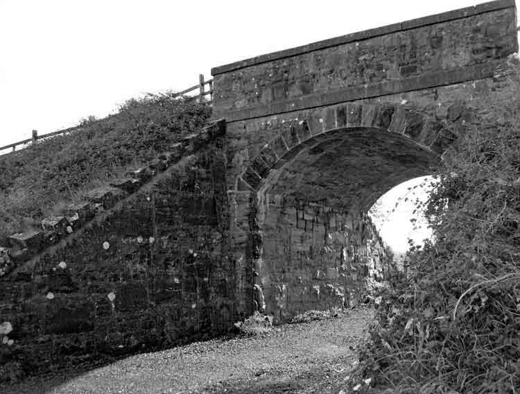 One of the three remaining single-arch railway bridges on the Ballina to Killala Railway (1893-1934). Walkers and cyclists now pass under the Overbridge at Meelick on the Ballina to Killala Greenway. Photo: Anthony Hickey
