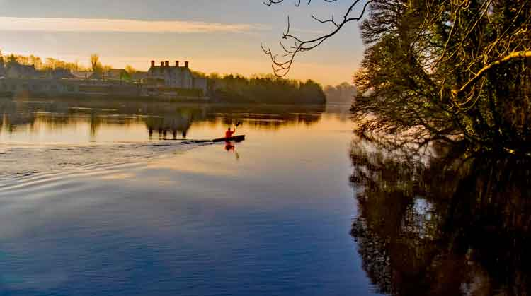 A Kayaker gliding over the calm waters of the river Moy at Belleek Wood, Ballina, Co Mayo. Photo: Anthony Hickey