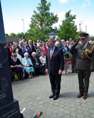 An Taoiseach Enda Kenny TD with his his Aide de Camp, Commandant Kieran Carey, after laying a wreath at the Great War Remembrance Monument in the Green Park, Ballina, on Saturday June 20th 2015. Photo: Anthony Hickey