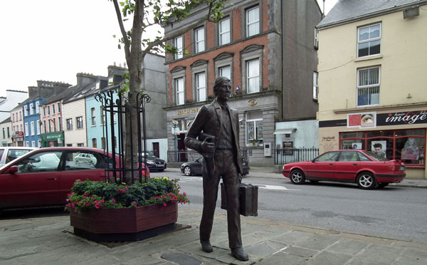 The life-size sculpture in Kiltimagh of an emigrant walking to the train station with his suitcase in hand commemorates all those who were forced to leave Mayo during the 20th century to find work in England and America. Picture Anthony Hickey