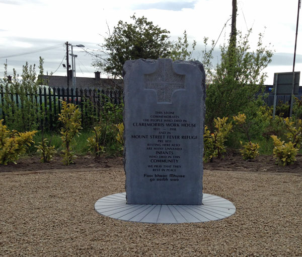 The commemorative stone marking the site of the burial ground where Famine and workshouse victims were buried in Claremorris.