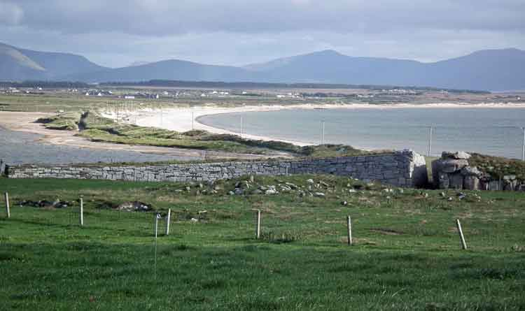 In the foreground, Acknowledgement, one of the sculptures on the North Mayo Sculpture Trail commemorating those buried in the Cleggan Island cillín. Srah beach in the background. Photo: Anthony Hickey