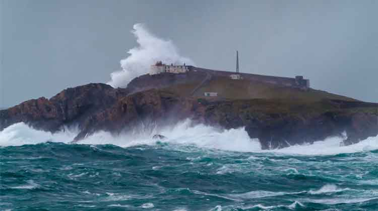 A wave breaking over the 67 metre high Eagle Island off the North Mayo coast. Photo Anthony Hickey