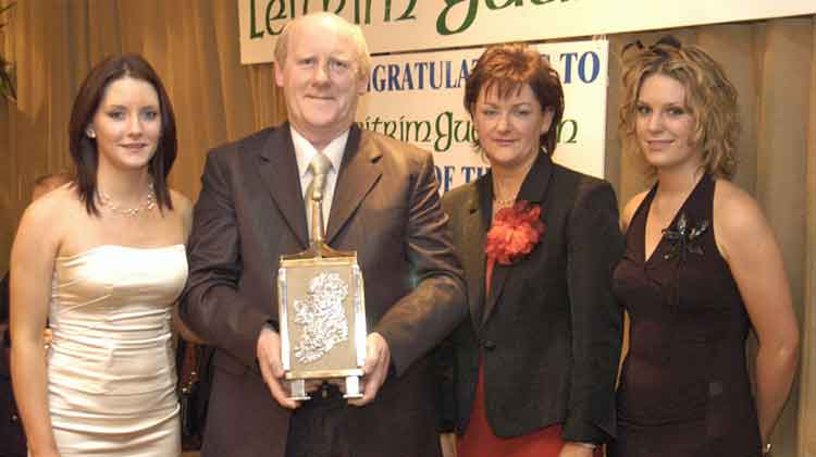 Willie Donnellan, Leitrim Village, receiving the Leitrim Guardian Person of the Year Award in 2004 with his wife, Marion, and daughters, Sarah and Rachel.