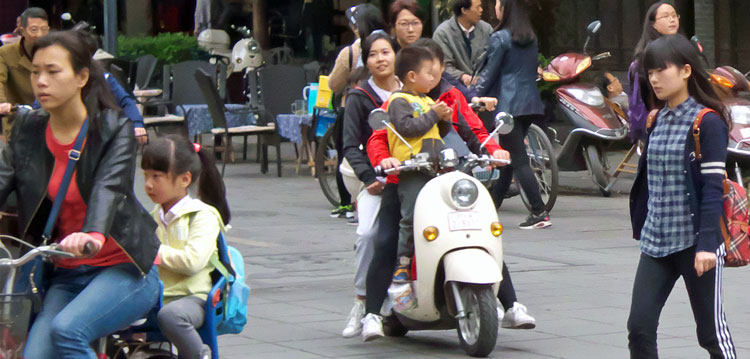 The School Run: Scooters are everywhere in Chengdu, China. Photo: Anthony Hickey