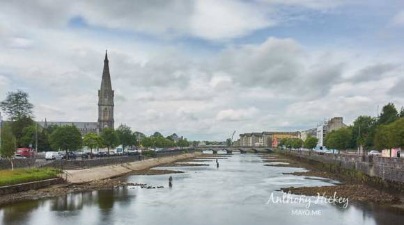 Anglers salmon fishing on the River Moy in Ballina between the Lower Bridge, and Ham Bridge and The Salmon Weir pedestrian bridge in the background, beneath the spire of St. Muredach's Cathedral. Photo: Anthony Hickey
